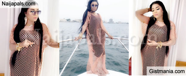 Cross Dresser, Bobrisky Slays As She Steps Out In A N*de Coloured Mesh Dress For A Boat Cruise (PIX)
