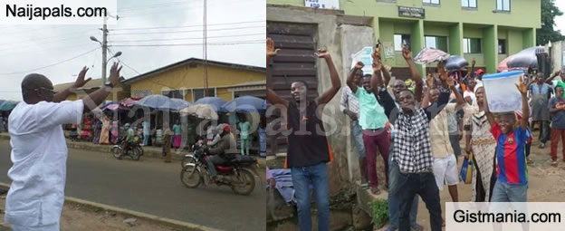 PHOTOS: Ekiti State Residents Pictured Cheering Gov. Fayose On The Street