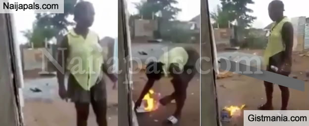 """The Bible Is Fake, There Is No Power In The Name Of Jesus"" - Ghanian Traditionalist Says As She Burns Holy Bible"