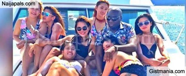 Nigerian Man Based In Dubai Poses With Many Filipino Girls On A Yacht (PHOTO)