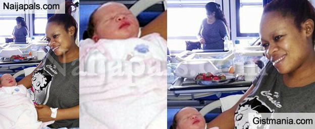 Confusion As Black Woman Gives Birth To White Red Headed Child - Photos