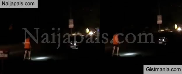 Nigeria My Nigeria! White Man Spotted Jogging With His Torchlight In Abuja Due To NO LIGHT - Photos