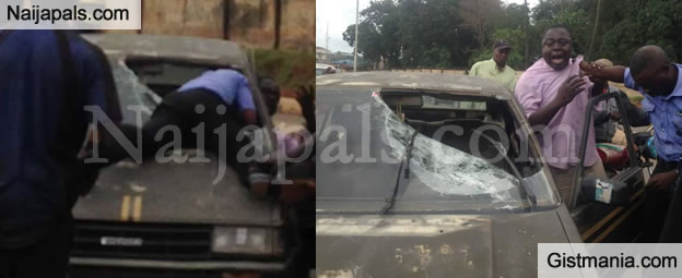 Serious Commotion As Policeman Smashed Man's Car After He Refused Him N100 Bribe in Ibadan