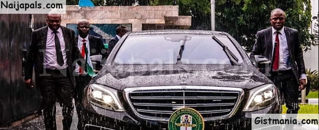Trending Photo Of New HOR Speaker, Gbajabiamila's Securities Running After His Car In Heavy Downpour