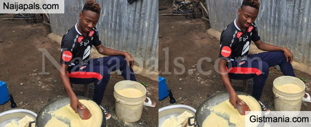 Arsenal Footballer, Kelechi Nwakali Pictured Frying Garri When Visiting His Mother In The Village