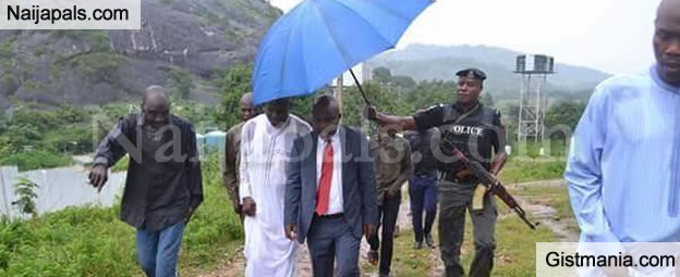 Outrage As Security Aide Holds Umbrella For a Commissioner In Kogi State (Photos)