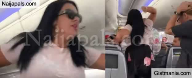 Lady Went Berserk After Seeing Her Man Staring At Other Women On A Plane
