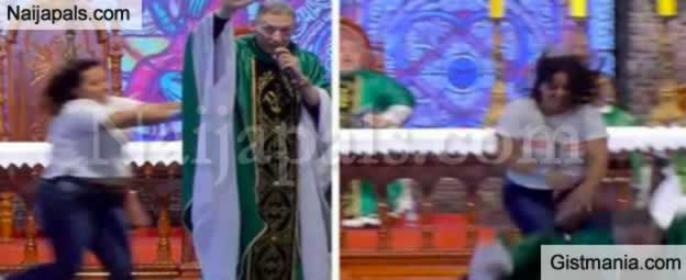 Drama In Brazil As Lady Pushes Catholic Priest Down From The Altar While He Was Preaching (Video)