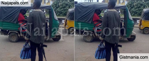 Man Carrying AK-47 Assault Riffle In Broad Daylight Causes Unease In Owerri (PHOTO)