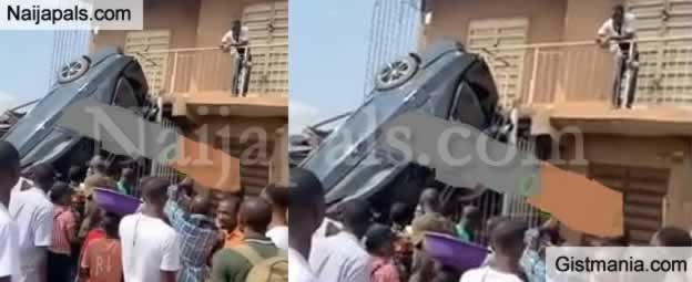 What A Narrow Escape! Tragedy Averted As A Car Crashes Into A Shop At Iyana Ipaja, Lagos