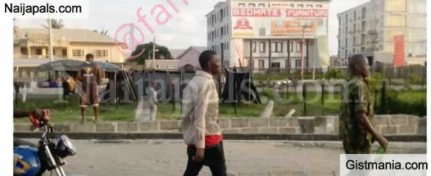 Drunk Soldier Spotted Strolling While Holding A Bottle Of Beer In Lekki