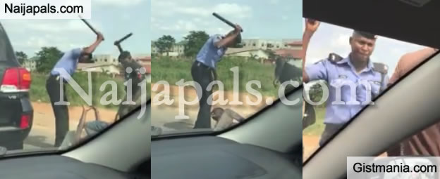 Two Policemen Beat Up A Unsuspecting Motorist For Refusing To Stop At Checkpoint (Photos Inside)