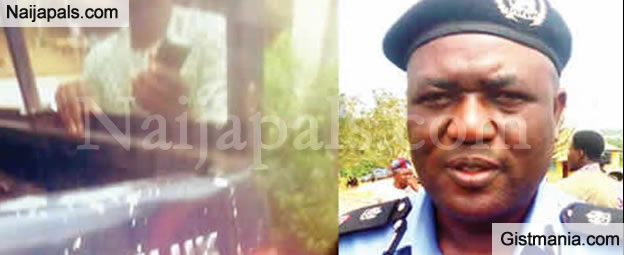SHM! Corrupt Nigerian Police Handcuffs Passenger To Vehicle After Driver Escaped (PHOTO)