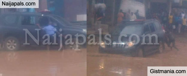 ONLY IN NAIJA! High Ranking Police Officers Seen Pushing Their Vehicle Stuck In Mud - Photos