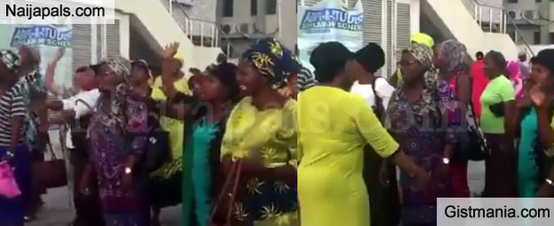 Nigerian Women Try To Quench A Burning Building With Serious Prayers (Photos/Video)