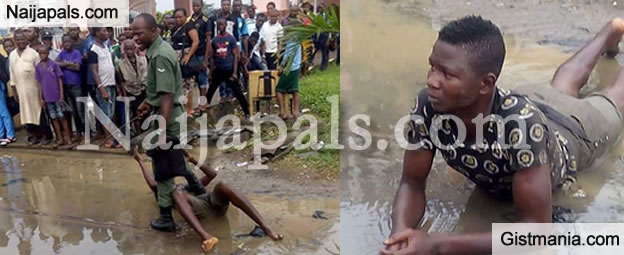 SMH! Soldier Beats Up and Drags Young Boy in Mud in Oshodi, Lagos (PHOTOS)