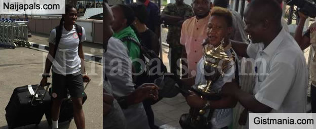 Victorious Super Falcons Flaunt The Trophy As They Arrive MMA, Lagos Amidst Great Cheers - Photos