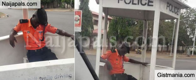Tired Looking Traffic Warden Caught Sleeping On Duty In Abuja (Photos)