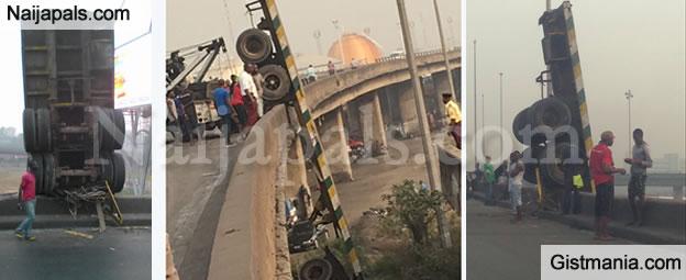 Big Truck Falls off Bridge in a Freak Accident in Lagos (PHOTO)