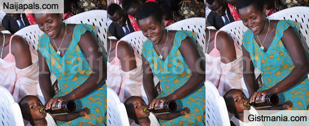 YaY OR NAY? Photo Of Ugandan Woman Giving Her Little Daughter Beer At An Event Gone Viral